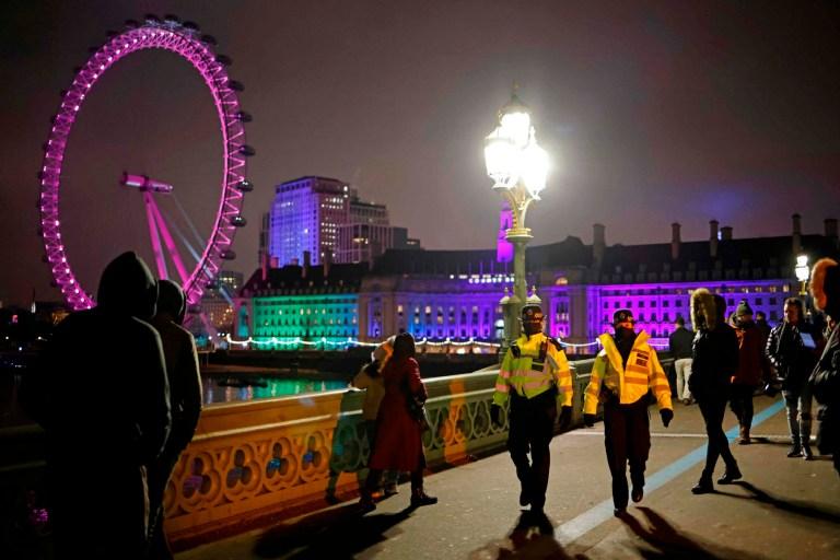 Police officers disperse people on Westminster Bridge