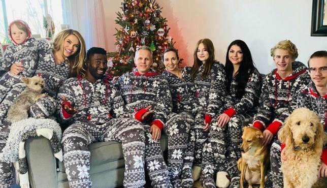 Chrishell Stause with her family and boyfriend Keo Motsepe sitting together in matching onesies