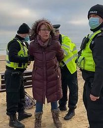 A woman is placed in handcuffs for allegedly refusing to leave Bournemouth beach