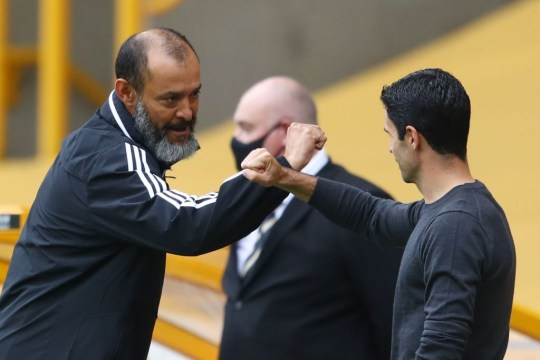 Wolverhampton Wanderers' Portuguese head coach Nuno Espirito Santo (L) and Arsenal's Spanish head coach Mikel Arteta (R) touch arms before kick off of the English Premier League football match between Wolverhampton Wanderers and Arsenal at the Molineux stadium in Wolverhampton, central England  on July 4, 2020.