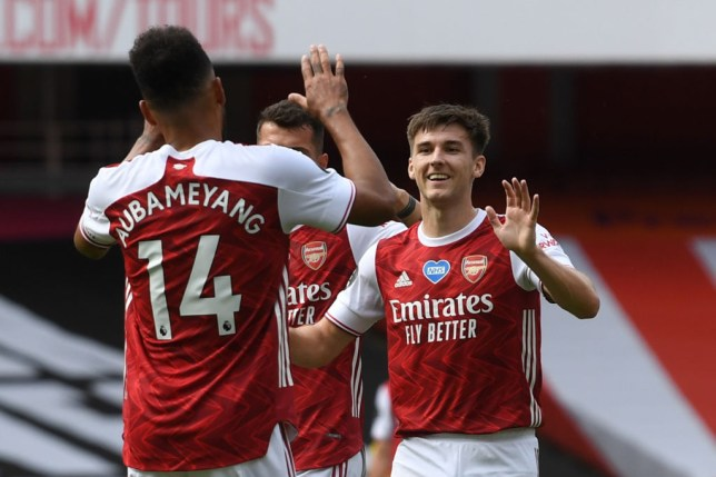 Arsenal's Scottish defender Kieran Tierney (R) celebrates with Arsenal's Gabonese striker Pierre-Emerick Aubameyang after scoring their second goal during the English Premier League football match between Arsenal and Watford at the Emirates Stadium in London on July 26, 2020.