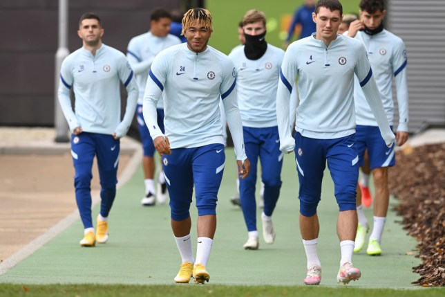 Reece James and Andreas Christensen look on in Chelsea training