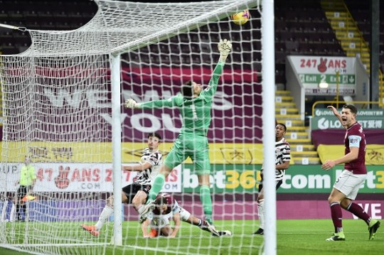 Harry Maguire heads home in the first half at Turf Moor