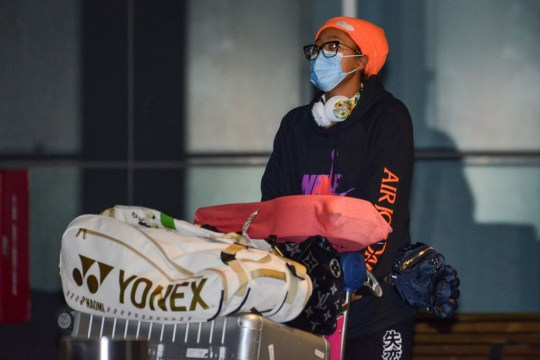 Japanese tennis player Naomi Osaka arrives before heading straight to quarantine for two weeks isolation ahead of her Australian Open warm up matches in Adelaide on January 14, 2021. (