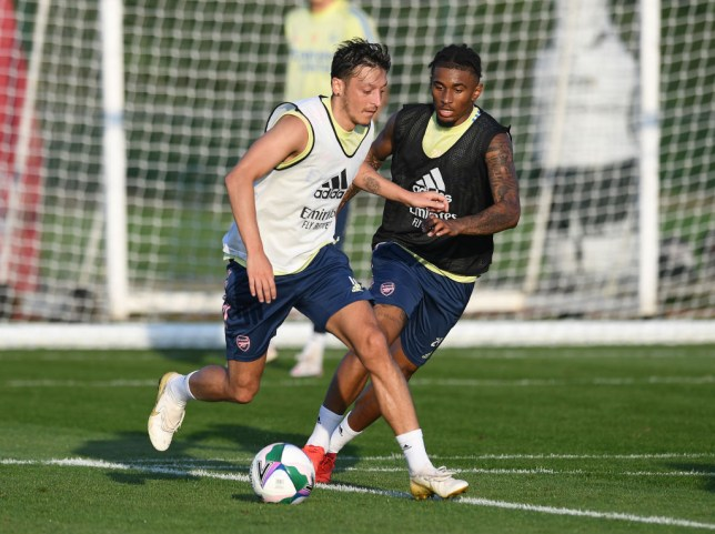 Mesut Ozil runs with the ball in Arsenal training