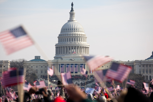 Crowds with american flags at the Capitol in Washington