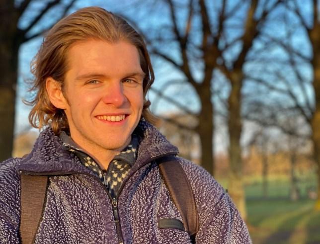 Connor Spratt smiling in a park