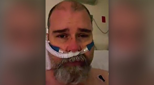A former Covid denier confessed he was wrong to dismiss the pandemic as he struggled to breathe with the virus in a harrowing video from his hospital bed