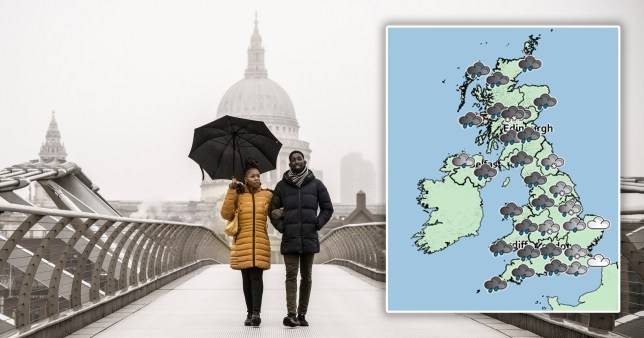 A couple cross the Millennium Bridge in London yesterday as icy rain and sleet battered the capital (Picture: PA Photo)