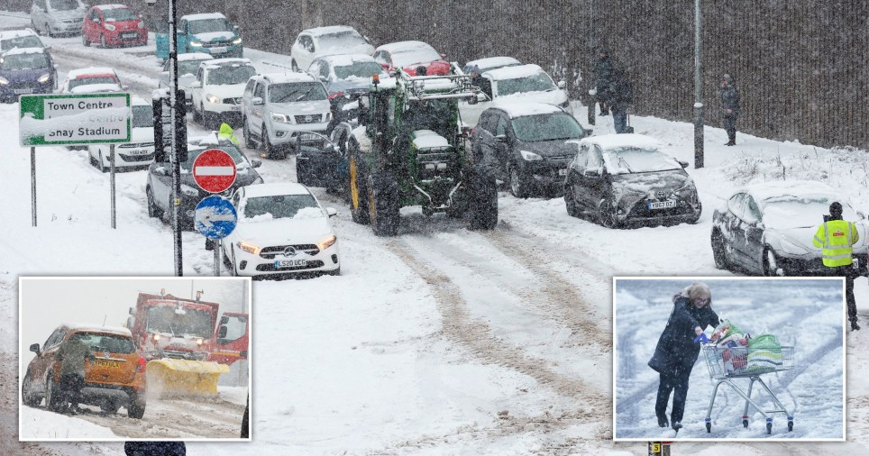 Tractors clear the road of heavy snow