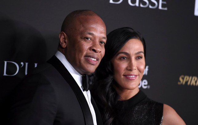 Dr. Dre, left, and Nicole Young arrive at the City of Hope Gala,