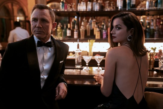 ames Bond (Daniel Craig) and Paloma (Ana de Armas) in NO TIME TO DIE