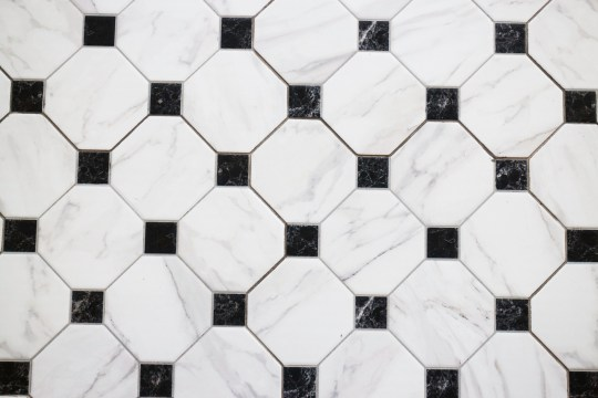 TILED HALLWAY - Black and white checkered marble floor, stock photo
