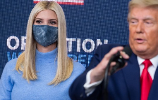 Ivanka Trump stands behind her dad Donald