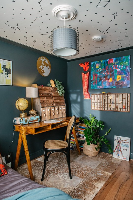 MUM-of-three Lily Sawye has transformed her drab Victorian terrace in Stratford, East London into a colourful wonderland on a budget using brave dark paint colours, patterned wallpaper and ??5 vintage finds. Picture shows: Lily???s son Issac???s room TRIANGLE NEWS 0203 176 5581 // contact@tringlenews.co.uk Pics By Emily Hall A MUM-of-three has transformed her drab Victorian terrace into a colourful wonderland on a budget using brave dark paint colours, patterned wallpaper and ??5 vintage finds. Lily Sawyer???s dreary three-bed pad was a sea of magnolia when she first moved in with every room painted either white or cream. But then Lily set to work to make her home an Instagram-worthy sensation by picking luscious dark shades - including black - and brightly-coloured floral wallpapers to really make the place pop. Lily and her husband David, a financial director, bought their home in Stratford, East London, for ??445,000 in 2014 and were initially wowed by its original features.