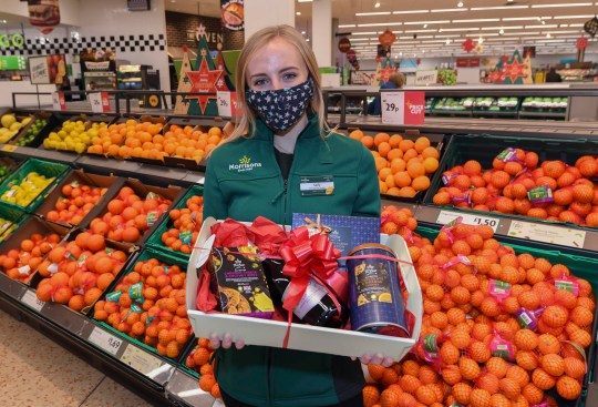 Staff member Sally O'Hara helps launch the Morrisons Acts of Community Kindness campaign, which will see the supermarket carry out over six thousand acts of kindness this Christmas, including delivering over 100,000 free mince pies to care homes, giving away flowers in local communities and surprising Covid-19 heroes with festive hampers.