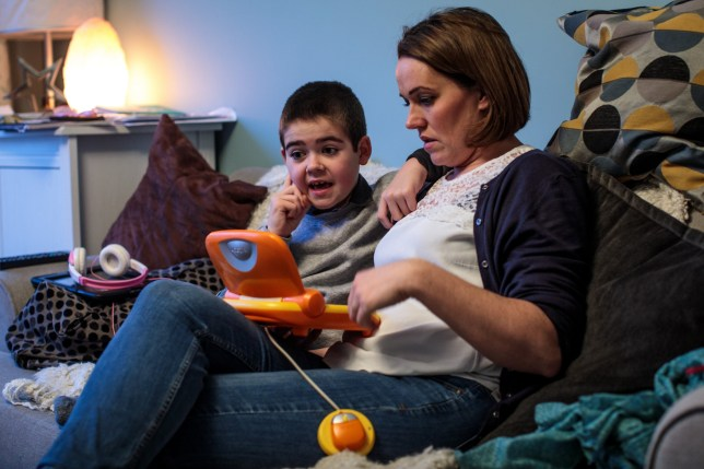 KENILWORTH, ENGLAND - JANUARY 13: Alfie Dingley plays a game with his mother Hannah Deacon at their home on January 13, 2019 in Kenilworth, England. Alfie Dingley, aged seven, suffers from PCDH19 which is a rare form of epilepsy that causes seizure clusters and learning difficulties. In June 2018, Alfie was granted a special license by the Home Office to use medicinal cannabis oil to treat his condition. Prior to taking his cannabis-based medicine, the recurrent seizures saw Alfie being rushed to hospital every 4-7 days but since taking cannabis oil Alfie has been seizure-free since July 2018. This treatment has allowed him to take up physical activities like cycling and horse riding. His mother, Hannah Deacon, continues to campaign for access to medicinal cannabis after newly published medical guidelines restrict its use. This currently leaves Alfie as the only holder of an NHS prescription for cannabis oil in the country. (Photo by Jack Taylor/Getty Images)