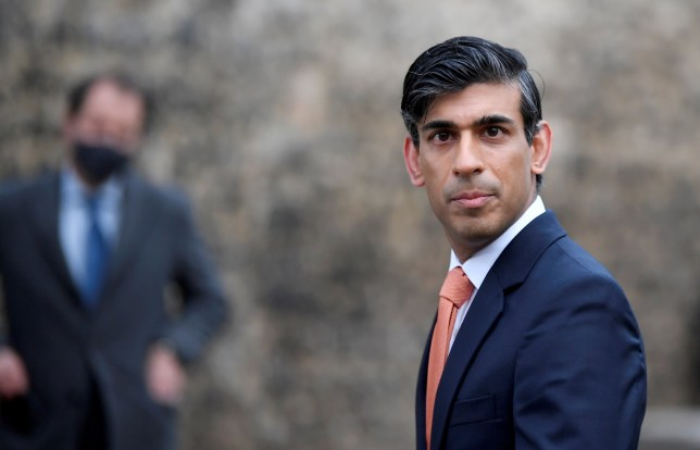 Rishi Sunak in a suit looking into the camera