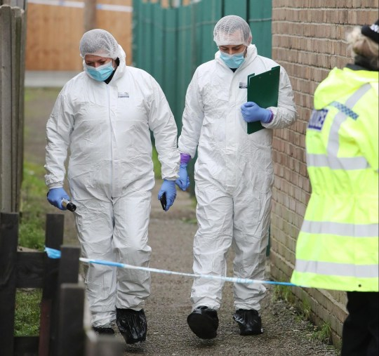Forensic officers investigate the death of Paul Fletcher, who was found dead in his home in Rayleigh, Essex, minutes into New Year's Day 2021