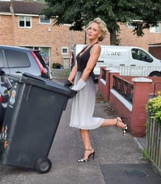 Meet Nicola Matthews, who spent nearly six months donning a different posh frock and heels every week to put her wheelie bin out. See SWNS story SWSYfrocks. Meet the woman who spent nearly six months donning a different posh frock and heels every week to put her wheelie bin out. Film make-up artist Nicola Matthews, 49, wanted to cheer people up during Covid so, inspired by Amanda Holden, she dressed up with props, full makeup and hair. She was initially photographed by neighbours pushing the bin outside her home. But what started as a one off became a regular photo shoot at 8pm each Wednesday evening, outside her home in Waltham Abbey, Essex. As the weeks progressed, Nicola embellished the idea with more props, including rubber gloves to match the dresses.