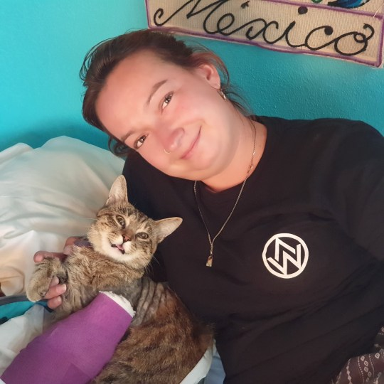 Willow Rolfe with Aimee the cat. See SWNS story SWSYmexico. A Brit couple have spent months trapped in Mexico through the coronavirus pandemic - because they can't bear to abandon their rescue CAT. Lee Hodges, 33, and his partner, Willow Rolfe, 29 set off for America in August, 2019, and headed south to Mexico in February when their visas were nearing their end. While in Washington DC, the pair of teachers from Birmingham rescued a cat, Aimee, from an animal shelter, and spent the rest of their trip tending to their new pet. When the pandemic began to spread they wanted to return home but they couldn't bare to leave their cat behind, so decided to stay.