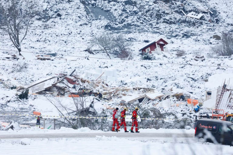 epa08915074 A rescue crew are about to search in the landslide area at Ask in Gjerdrum municipality, Norway, 02 January 2021. Several homes have been taken by the avalanche and nine people remain missing after one body was found. More than 1,000 people in the area have been evacuated. EPA/Haakon Mosvold Larsen NORWAY OUT