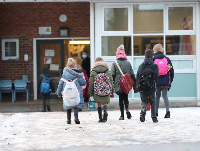 Pupils arrive at Manor Park School and Nursery in Knutsford, Cheshire, as schools across England return after the Christmas break. PA Photo. Picture date: Monday January 4, 2021. Prime Minister Boris Johnson has said parents should send primary-age children back to schools which remain open this week, despite growing calls from unions for them to close. See PA story HEALTH Coronavirus. Photo credit should read: Martin Rickett/PA Wire