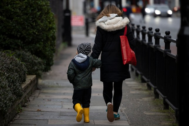 Parent with a child walking down the street