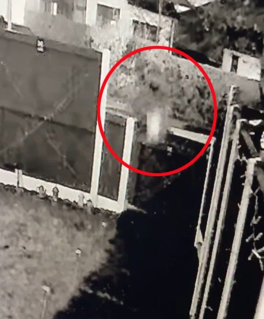 A delivery driver was caught on CCTV lobbing a package through the air into a woman's garden. Video shows a man tossing the item over the woman's gate and it landing several feet up the garden path at the house in Ellesmere Port, Cheshire. Credit: CheshireLive/MEN