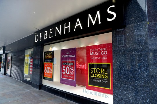 Closing down signs in the window of Debenhams in Worcester.
