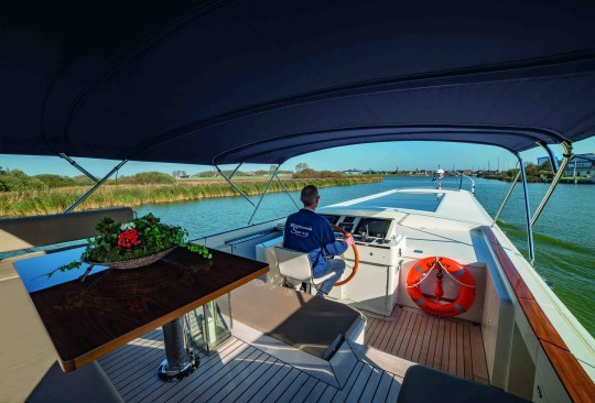 driving luxury houseboat