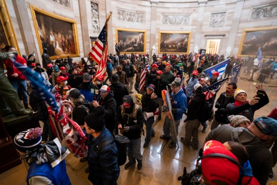 epa08923423 Supporters of US President Donald J. Trump in the Capitol Rotunda after breaching Capitol security in Washington, DC, USA, 06 January 2021. Protesters entered the US Capitol where the Electoral College vote certification for President-elect Joe Biden took place. EPA/JIM LO SCALZO Trump/BLM comparison