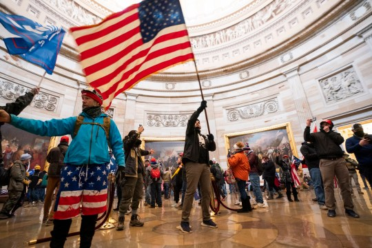 Supporters of US President Donald J. Trump in the Capitol Rotunda after breaching Capitol security in Washington, DC, USA