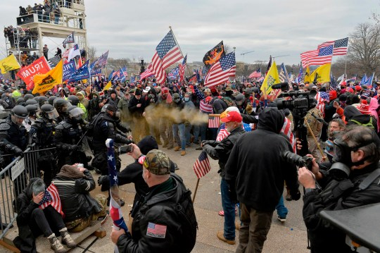 Trump supporters clash with police and security forces as they storm the US Capitol in Washington D.C on January 6, 2021.