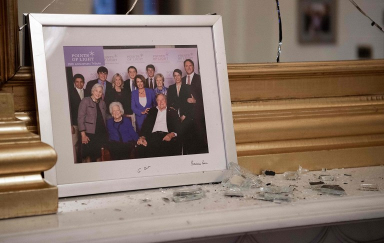 Broken glass litters a mantle as supporters of US President Donald Trump trespass in the office of Speaker of the House Nancy Pelosi as he protest inside the US Capitol in Washington, DC, January 6, 2021. - Demonstrators breeched security and entered the Capitol as Congress debated the a 2020 presidential election Electoral Vote Certification. (Photo by SAUL LOEB / AFP) (Photo by SAUL LOEB/AFP via Getty Images)