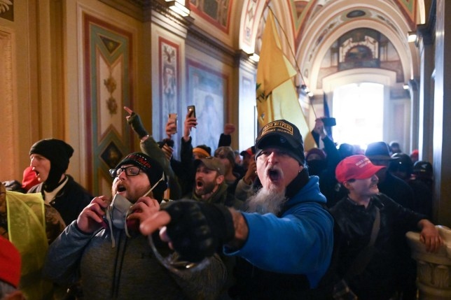 TOPSHOT - Supporters of US President Donald Trump protest inside the US Capitol on January 6, 2021, in Washington, DC. - Demonstrators breeched security and entered the Capitol as Congress debated the a 2020 presidential election Electoral Vote Certification. (Photo by ROBERTO SCHMIDT / AFP) (Photo by ROBERTO SCHMIDT/AFP via Getty Images) Trump/BLM comparison