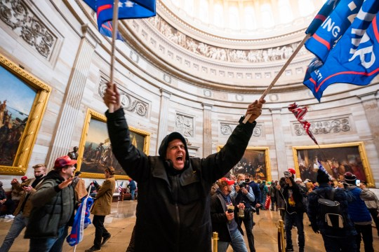 epaselect epa08923451 Supporters of US President Donald J. Trump in the Capitol Rotunda after breaching Capitol security in Washington, DC, USA, 06 January 2021. Protesters entered the US Capitol where the Electoral College vote certification for President-elect Joe Biden took place. EPA/JIM LO SCALZO Trump/BLM comparison