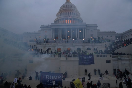 Police officers stand guard as supporters of U.S. President Donald Trump gather in front of the U.S. Capitol Building in Washington, U.S., January 6, 2021.