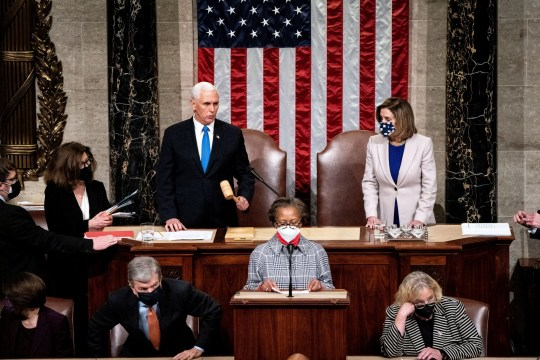 Vice President Mike Pence and House Speaker Nancy Pelosi resume presiding over a Joint session of Congress to certify the 2020 Electoral College results, after supporters of President Donald Trump stormed the Capitol earlier in the day, on Capitol Hill in Washington, U.S. January 7, 2021. Erin Schaff/Pool via REUTERS REFILE - CORRECTING DATE