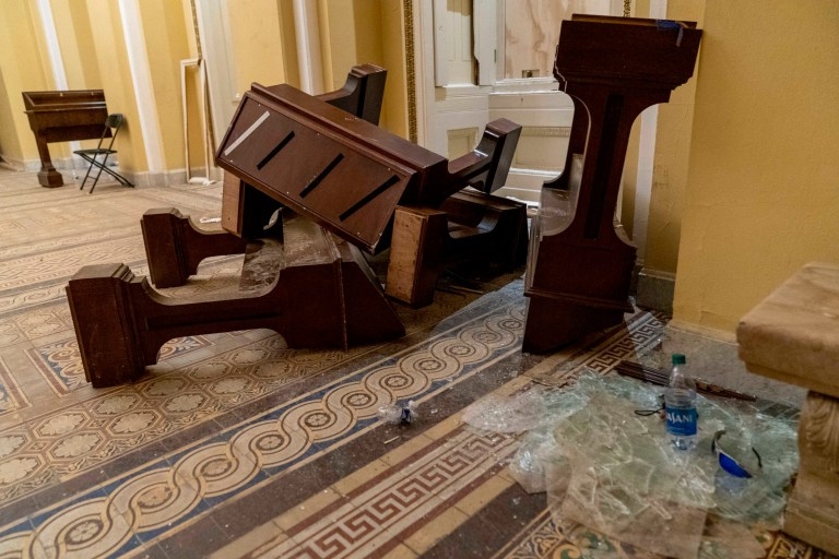 Damage is visible in the hallways in the early morning hours of Thursday, Jan. 7, 2021, after protesters stormed the Capitol in Washington, on Wednesday. (AP Photo/Andrew Harnik)
