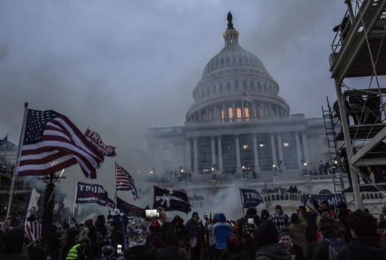 Mandatory Credit: Photo by Probal Rashid/ZUMA Wire/REX (11695732n) Security forces respond with tear gas after the US President Donald Trumps supporters breached the US Capitol security in Washington D.C., United States on January 06, 2021. Pro-Trump rioters stormed the US Capitol as lawmakers were set to sign off Wednesday on President-elect Joe Biden's electoral victory in what was supposed to be a routine process headed to Inauguration Day. Trump Supporters Storm US Capitol, Washington, District of Columbia, U.S.A - 06 Jan 2021