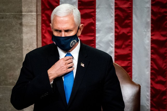 TOPSHOT - Vice President Mike Pence presides over a Joint session of Congress to certify the 2020 Electoral College results after supporters of President Donald Trump stormed the Capitol earlier in the day on Capitol Hill in Washington, DC on January 6, 2020. - Members of Congress returned to the House Chamber after being evacuated when protesters stormed the Capitol and disrupted a joint session to ratify President-elect Joe Biden's 306-232 Electoral College win over President Donald Trump. (Photo by Erin Schaff / POOL / AFP) (Photo by ERIN SCHAFF/POOL/AFP via Getty Images)