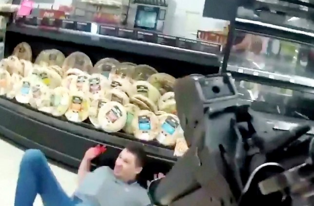 Shocking body-worn-video footage shows the moment armed police officers confronted and disarmed a man armed with a knife in an Asda supermarket. See SWNS story SWMDknife. At about 9pm on November 19, 2020, a number of 999 calls began coming into the Northamptonshire Police Force?s Control Room from terrified members of the public who had been threatened at knife-point by 22-year-old Mantas Auryla at the store in Raunds. Police call handlers took the calls and specially trained armed officers were immediately deployed and the store was evacuated. Video footage released by police today (January 11, 2021) shows the moment officers entered the empty store on the hunt for Auryla. They swiftly located him, disarmed and arrested him, before he was subsequently charged with two counts of having a blade/article which was sharply pointed in public place and public affray. He was sentenced to eighteen months in prison.
