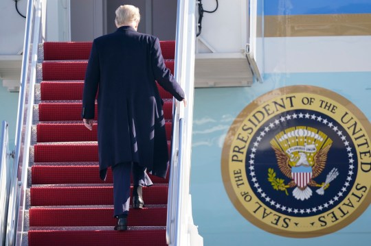 President Donald Trump boards Air Force One