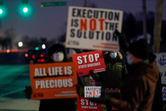 Activists in opposition to the death penalty gather to protest the execution of Lisa Montgomery, who is scheduled to be the first woman put to death by the federal government in nearly 70 years, at the United States Penitentiary in Terre Haute, Indiana, U.S. January 12, 2021. REUTERS/Bryan Woolston TPX IMAGES OF THE DAY