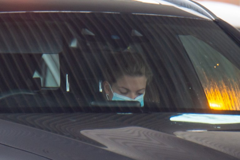 Zara Holland wearing mask sat in passenger seat of car at petrol station