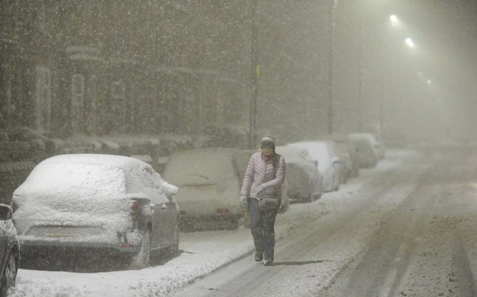 Dated:14/01/2021 HEAVY SNOWFALL COUNTY DURHAM A commuter braves the blizzard conditions in Consett, County Durham as the snow continues to fall this morning (THURS) following heavy snowfall overnight. See snow round-up