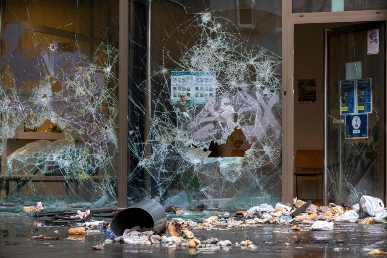 This general view shows shattered windows and debris at a police station on the 'Place Liedts - Liedtsplein in Schaarbeek-Schaerbeek, Brussels on January 14, 2021, after the escalation of a protest in which some 500 participants demanded more information after the death of 'Ibrahima B', who died last week allegedly after a police intervention. (Photo by NICOLAS MAETERLINCK / BELGA / AFP) / Belgium OUT (Photo by NICOLAS MAETERLINCK/BELGA/AFP via Getty Images)