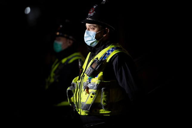 CARDIFF, WALES - JANUARY 14: A police officer looks on during a protest outside Cardiff Bay police station following the death of Mohamud Mohammed Hassan who died shortly after his release from police custody on January 14, 2021 in Cardiff, Wales. Mohamud Mohammed Hassan was arrested at his Cardiff home on Friday on suspicion of a breach of the peace but released without charge on Saturday morning. The 24-year-old died on Saturday night and his family said he claimed he was assaulted in custody. South Wales Police has said no evidence of excessive force or misconduct has been found so far and has referred itself to the Independent Office for Police Conduct (IOPC). (Photo by Matthew Horwood/Getty Images)