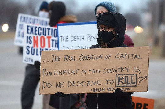 Anti-death penalty protesters holding placards